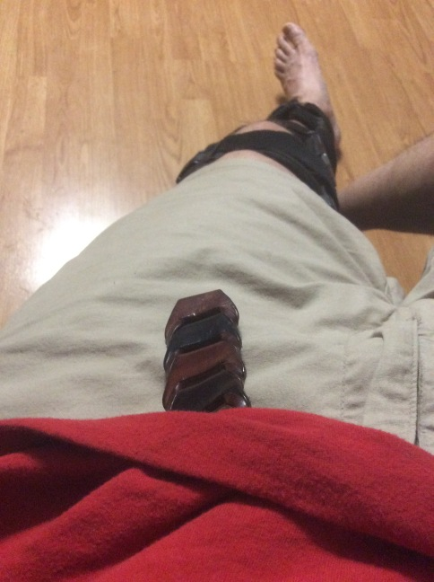 Red shirt, leather belt and khaki shorts