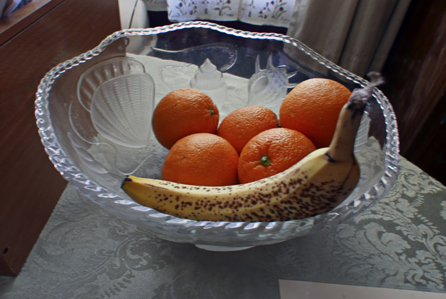 Spotted banana and five oranges
