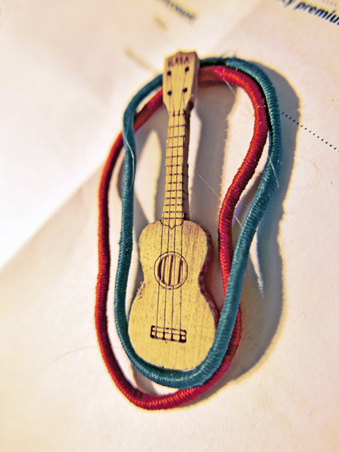 Cracker Jack sized ukulele and hair ties
