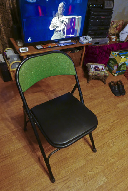 1955 Samsonite folding chair and Alicia Keys of The Voice. The Samsonite chair was a gift to my parents from my dad's parents early in the first years of their marriage. The seat was recovered today with repurposed leather from my worn out recliner.
