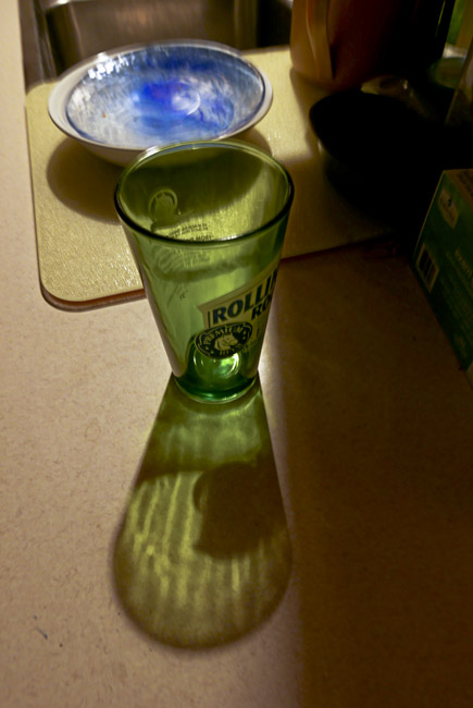 Empty Rolling Rock glass