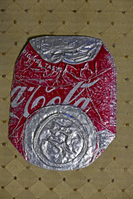 Traffic flattened soda can