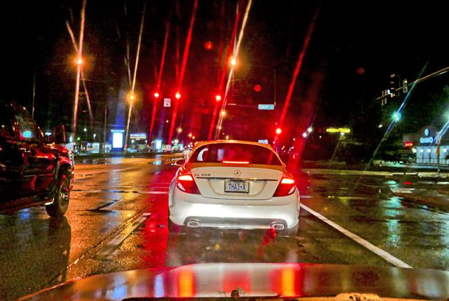 Rain-soaked white Mercedes