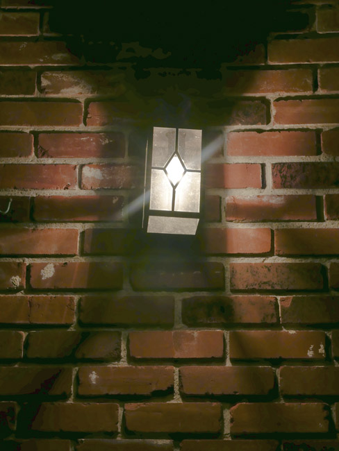 Carriage porch light and reused and repurposed bricks