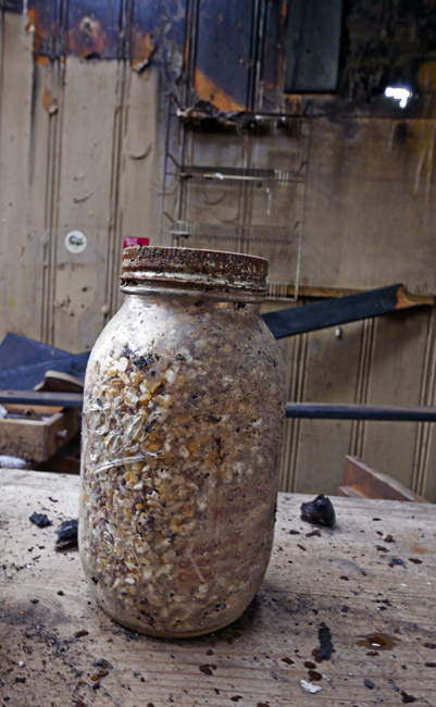 A jar of seed corn is all that remains after the fire at Jenkin's Feed in Hollister, Missouri.
