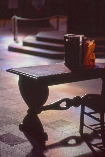 Table and chair illuminated by the afternoon filtered stand glass windows of Grace Cathedral in San Francisco.