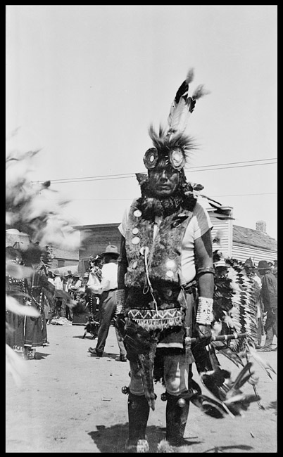 Indian gentleman in tribal dress at local county fair somewhere in the American west.