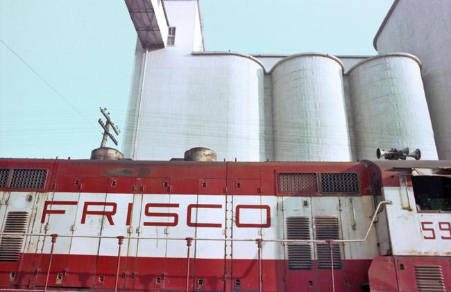 Frisco locomotive and Springfield silos, circa 1978