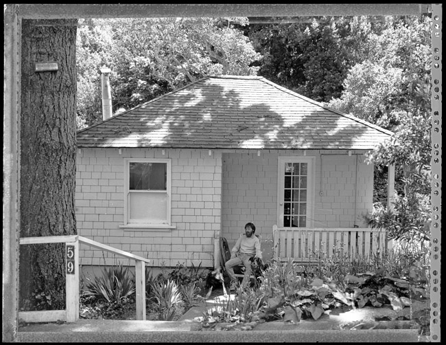 Rema, Len, and Poppy hanging out on the front porch of their new pink rental property in Sausalito, California, circa 1990. The film shot was Polaroid Type 55 positive/negative film.