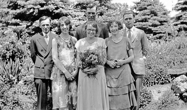 Walter and Bertha Sprick's wedding day, circa 1929. Standing from L - R; Earl Kingston, Bonnie Deich, Bertha Sprick and Walter Sprick, Pat Slayton, and Earl Slayton. We still have my grandmothers wedding dress.